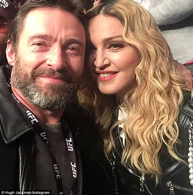 Cosying up!Hugh Jackman and Madonna were spotted together at the UFC lightweight title fight in New Yow on Sunday