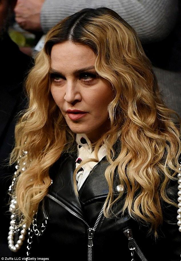 Trademark: Madonna let her signature blonde tresses cascade over her slender shoulders in loose curls
