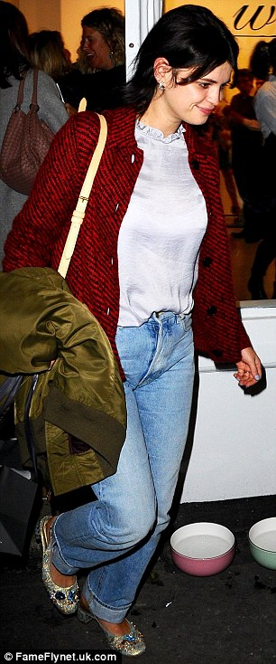 Casual chic: Pixie stepped out in jeans and a red cardigan with glittering ballet pumps