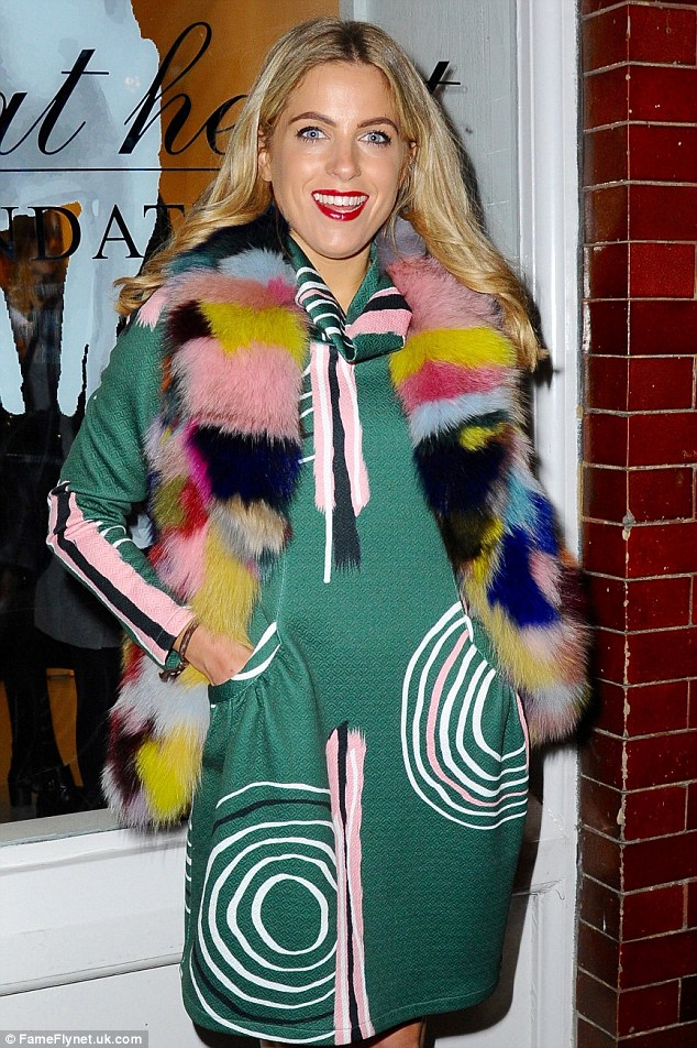 Big and bold: The star's coat dress featured white swirls and pink stripes