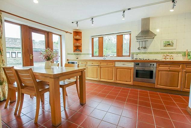 The home boasts three spacious bedrooms and a roomy, tiled-floored kitchen/diner, plus a separate dining room