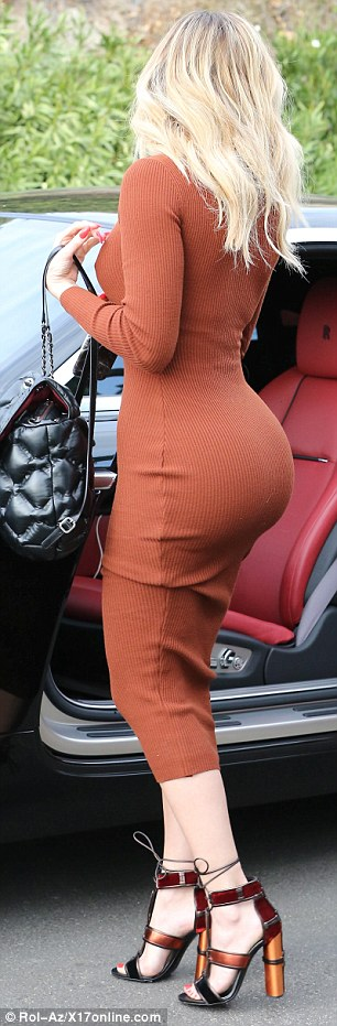 Flawless:Khloe's tiny waist and pert derriere were on full display in the clingy number, which featured long sleeves and a high-neck