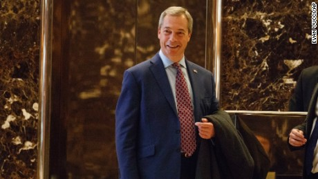 U.K. Independence Party leader Nigel Farage smiles as he arrives at Trump Tower, Saturday, Nov. 12, 2016, in New York.