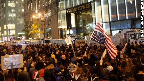 NEW YORK, NY - NOVEMBER 9: Hundreds of protestors rallying against Donald Trump gather outside of Trump Tower, November 9, 2016 in New York City. Republican candidate Donald Trump won the 2016 presidential election in the early hours of the morning in a widely unforeseen upset. (Photo by Drew Angerer/Getty Images)