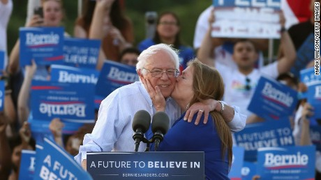 WASHINGTON, DC - JUNE 09:  Sen. Bernie Sanders (I-VT), gets a kiss from his wife Jane O'Meara Sanders after speaking at a campaign rally at Robert F. Kennedy Memorial Stadium June 9, 2016 in Washington, DC. After a meeting with President Barack Obama earlier at the White House, Sanders said he will work with Hillary Clinton to beat Donald Trump in the presidential election.  (Photo by Mark Wilson/Getty Images)