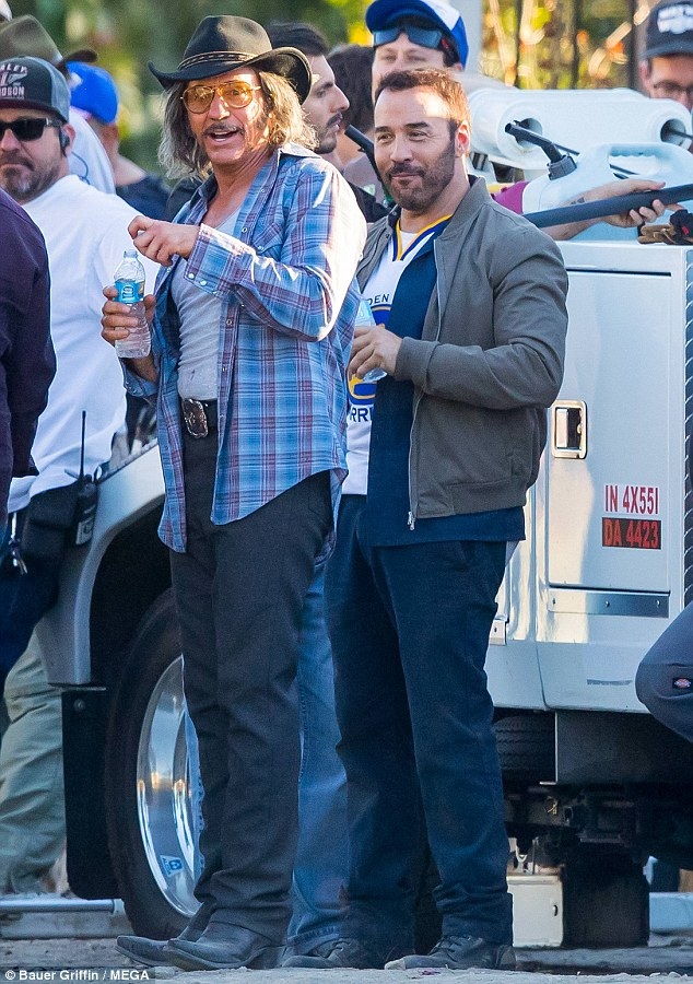 Good times: Actors Jeremy Piven, 51 and Robert Downey Jr., 51, were spotted on Friday in Los Angeles taking a break from filming the upcoming comedy film, All-Star Weekend