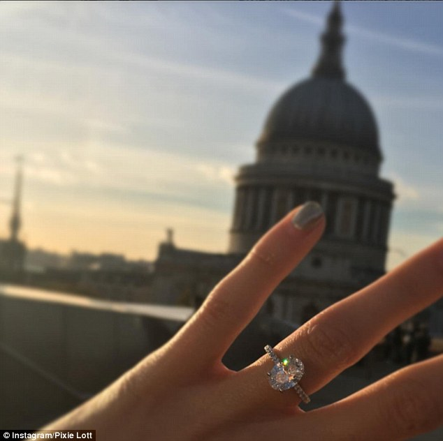 Sharing the joy:Pixie, 25, exclaimed it was the 'biggest surprise ever' as she showed off a dazzling diamond ring, adding simply in the photo's caption: 'so happy'