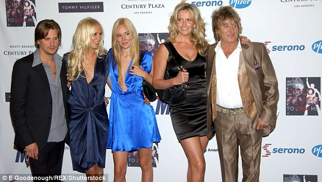 A family affair: Ruby in electric blue with her siblings reality stars Kimberly Stewart and Sean Stewart, and wife Penny Lancaster