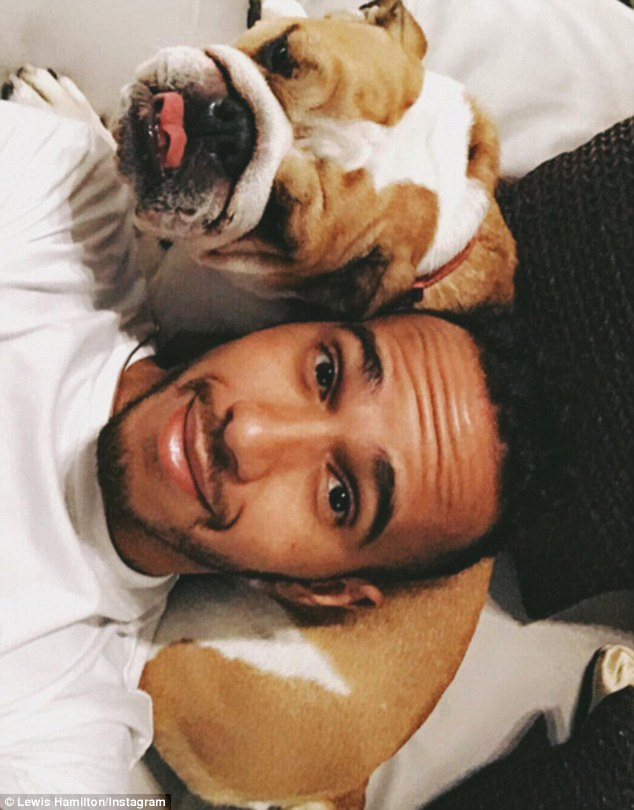 Man's best friend: Lewis posted a snap of himself hanging out with his dog Coco