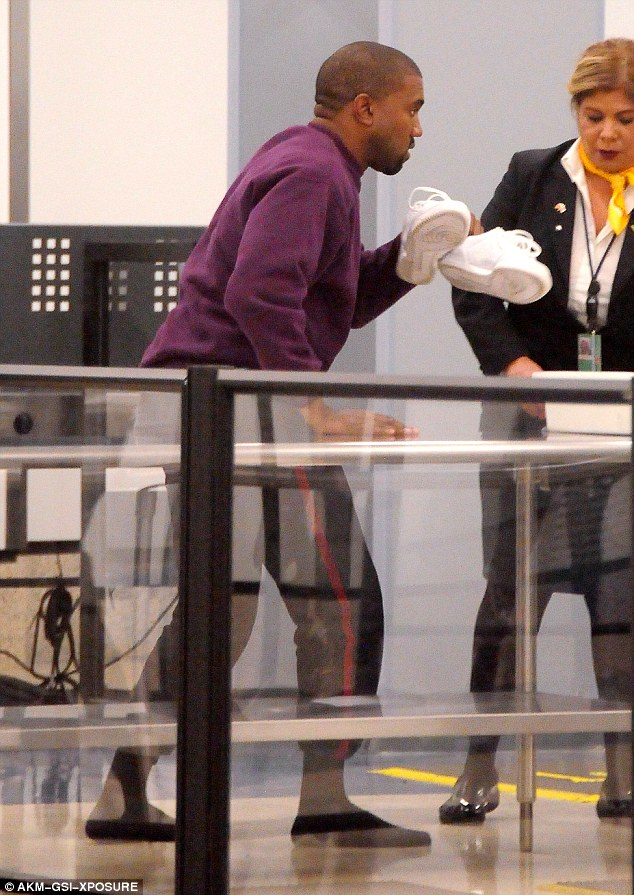 Dutiful: The star was seen dutifully following the security procedures as he removed his shoes for the checkpoint