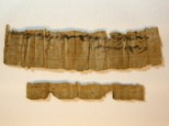 An ancient papyrus manuscript from the time of the First Temple during a press call in Jerusalem ©Menahem Khana (AFP)