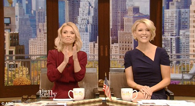 Megyn Kelly is pictured on Live with Kelly next to host Kelly Ripa