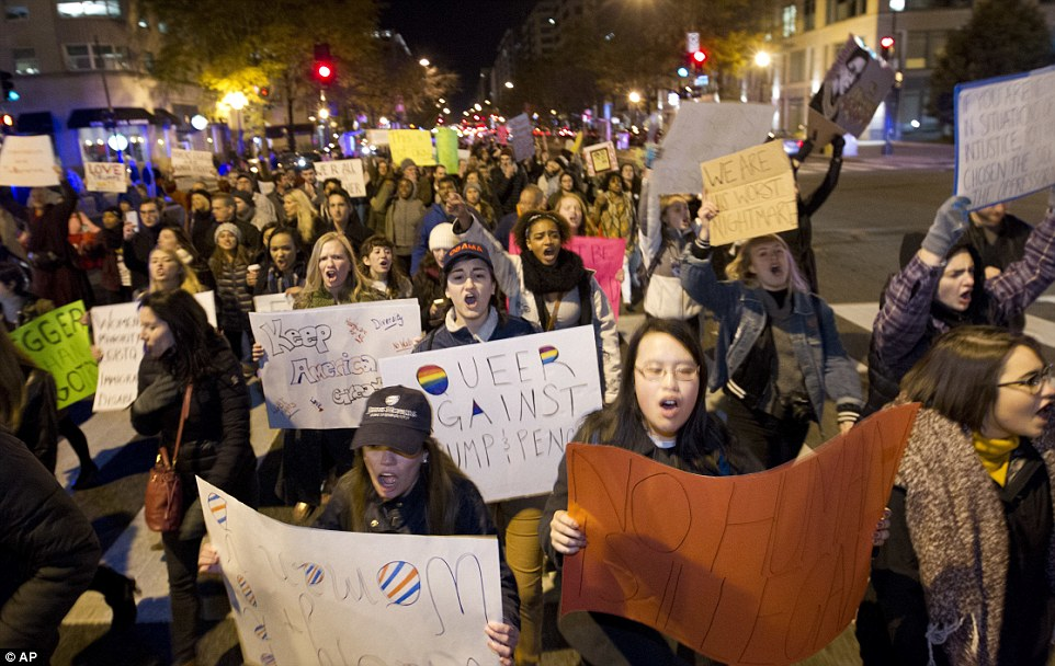 More protesters in Washington march to tell Trump they are his 'worst nightmare' in the fourth night of chaos since his shock election win
