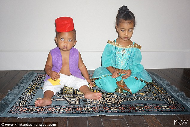 Too cute! North, three and Saint, 11-months were dressed up in adorable Aladdin and Jasmine costumes as they sat on a magic carpet