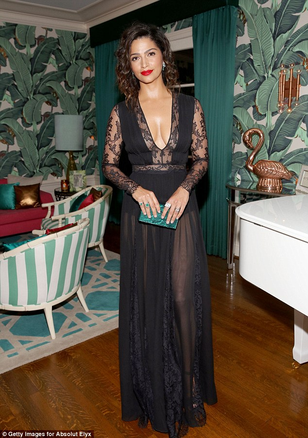 When you got it: The 34-year-old's largely sheer black dress bared her cleavage and offered a view of her exquisitely toned legs