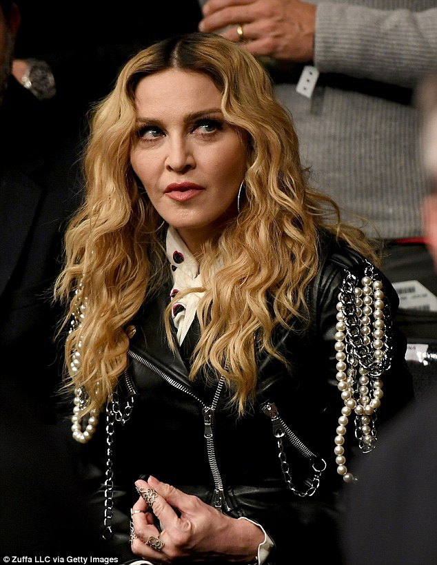 Vogue - strikes and blows: Madonna lead the celebs packing into Madison Square Garden for UFC 205 on Saturday night