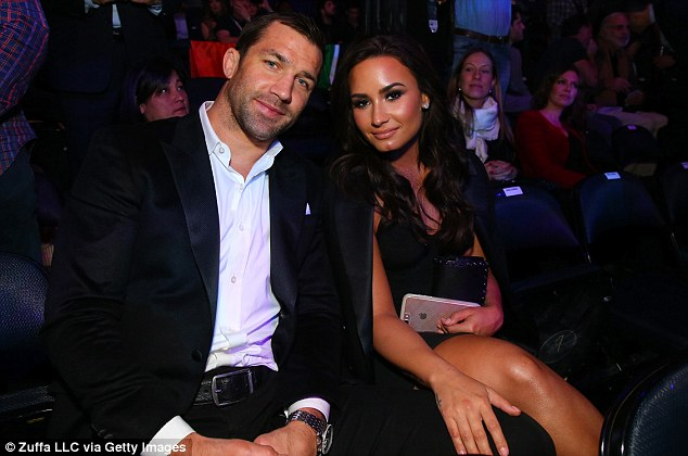 Official: Demi Lovato finally confirmed her relationship status with MMA fighter Luke Rockhold when they arrived hand in hand at the event