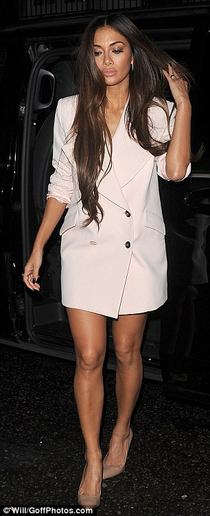 Forget something? Nicole changed into a pink jacket and nothing else after teh show as she headed out to dinner in London's Mayfair