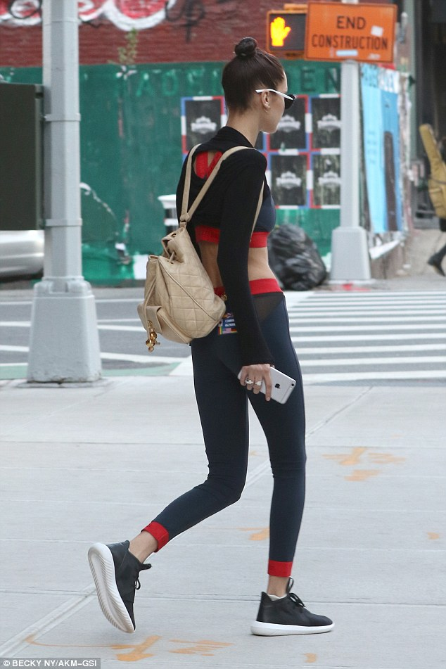 Cosmopolitan: The fashionista clutched an iPhone as she walked in the Big Apple