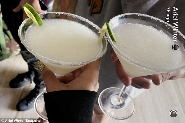 Cheers: She and a friend also clinked together a pair of frozen martinis