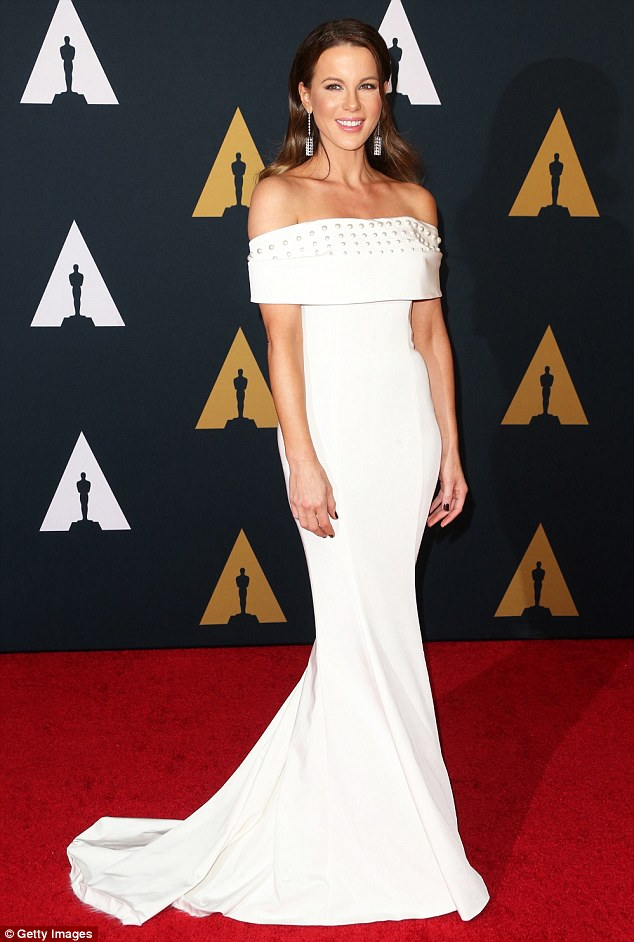 Fancy: Kate Beckinsale stepped out in a white embellished frock for the awards ceremony
