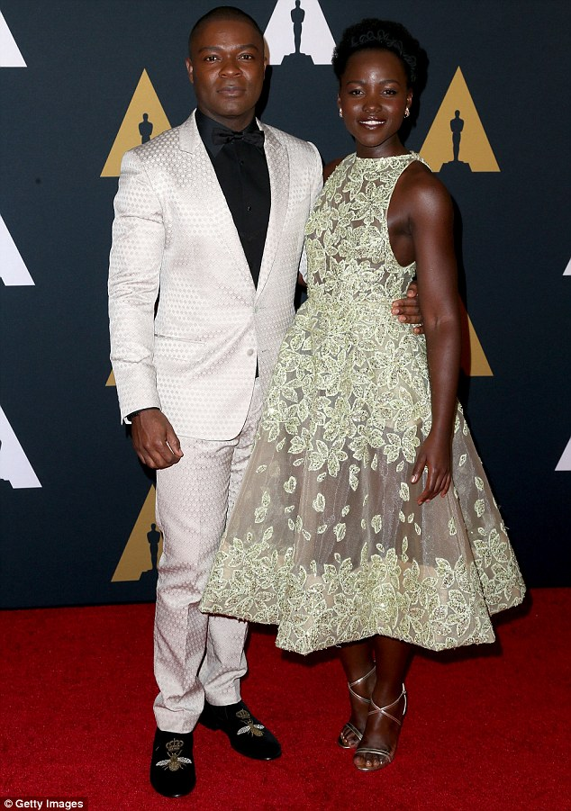 Reunited: Lupita posed with David on the carpet- her co-star in the film Queen Of Katwe