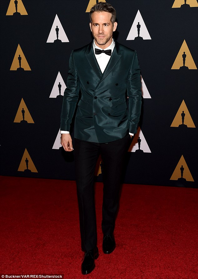 Handsome: Ryan Reynolds arrived on the red carpet in an emerald blazer with black trousers, a white button-up and a bow-tie