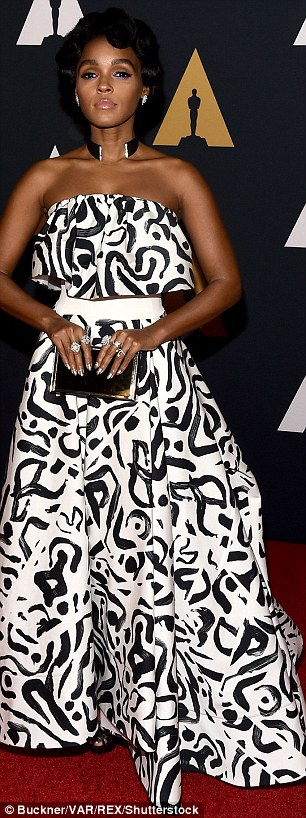 Good choice: Janelle Monae looked pretty in a black and white strapless dress; the look had a cinched waist with a voluminous top and skirt