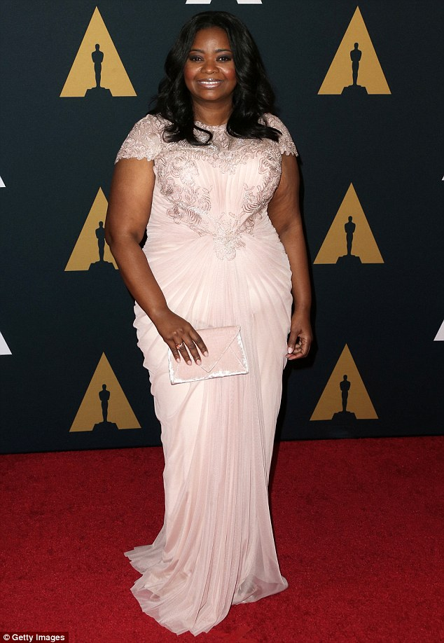 She's got a glow: Octavia Spencer looked great in a blush-toned ruched dress, opting for loose tresses to finish off her look