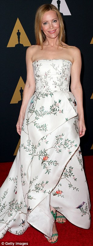 Smile: The actress, 44, wore a strapless dress with branches and birds emblazoned all over