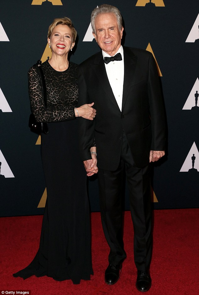 Staying close: Warren Beatty, 79, wore a suit and bow tie while his wife Annette Bening, 58, showed off her incredible figure in a sheer lacy dress