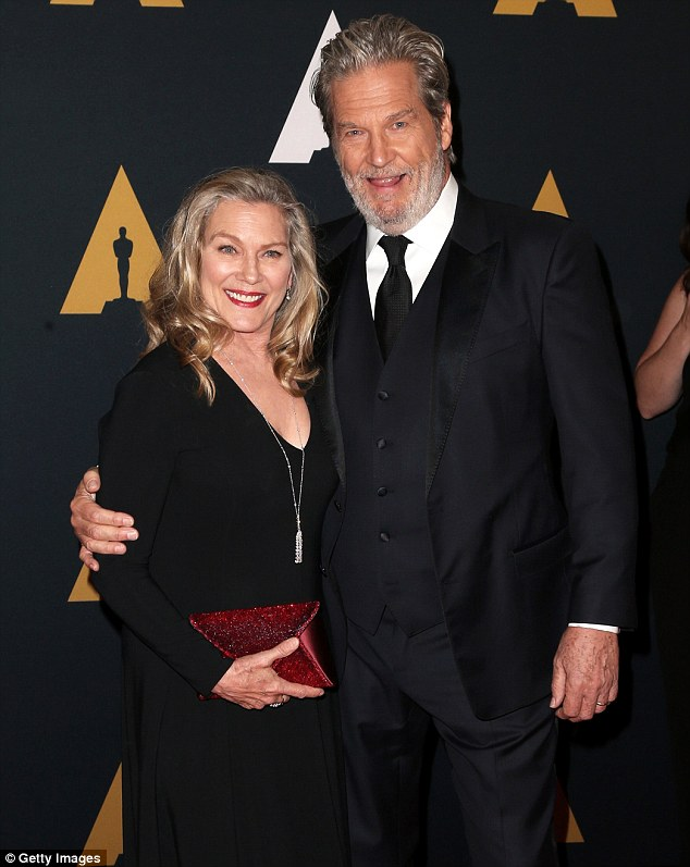 Giddy: Jeff Bridges and wife Susan Geston Bridges coordinated in dark hued looks; Susan added a pop of color with a maroon clutch