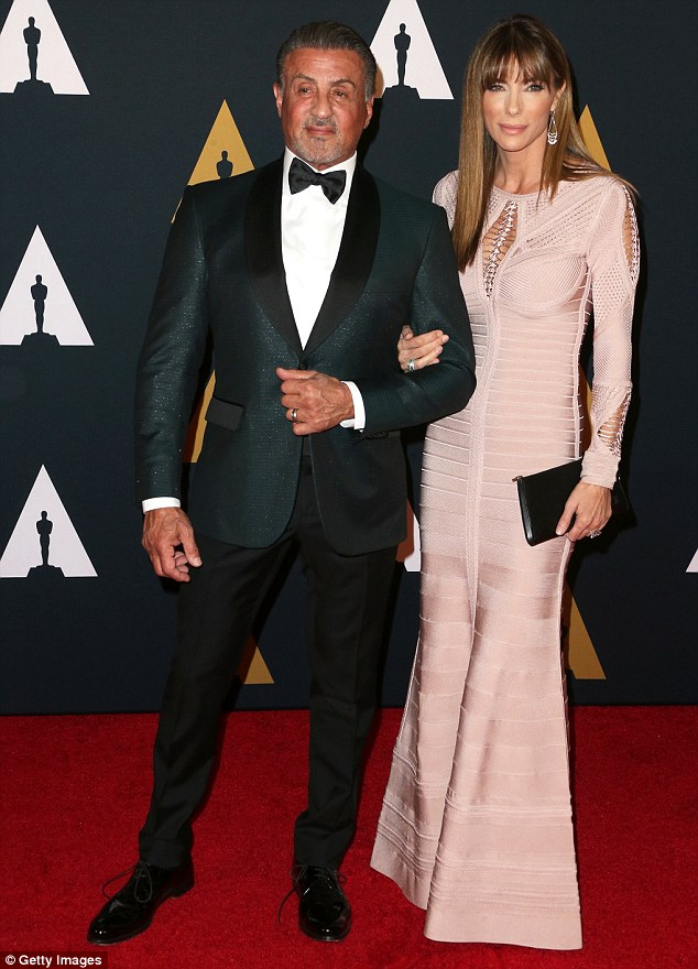 Date night: Sylvester Stallone posed on the carpet with his wife Jennifer Flavin, who donned a textured blush frock