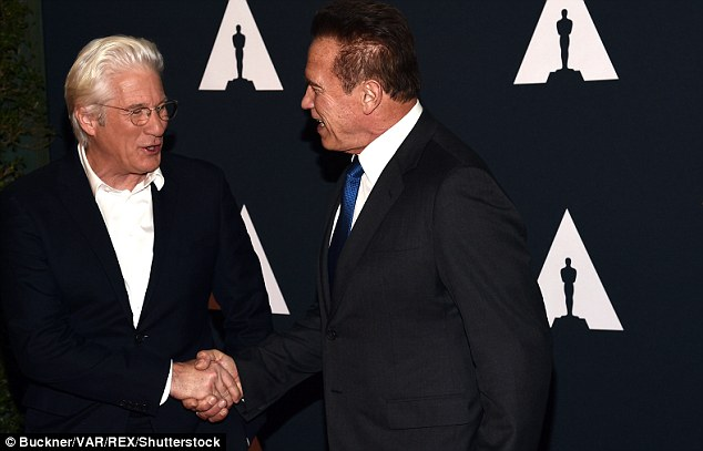 Shaking hands before heading in: While on the carpet, he was seen greeting fellow actor Richard Gere