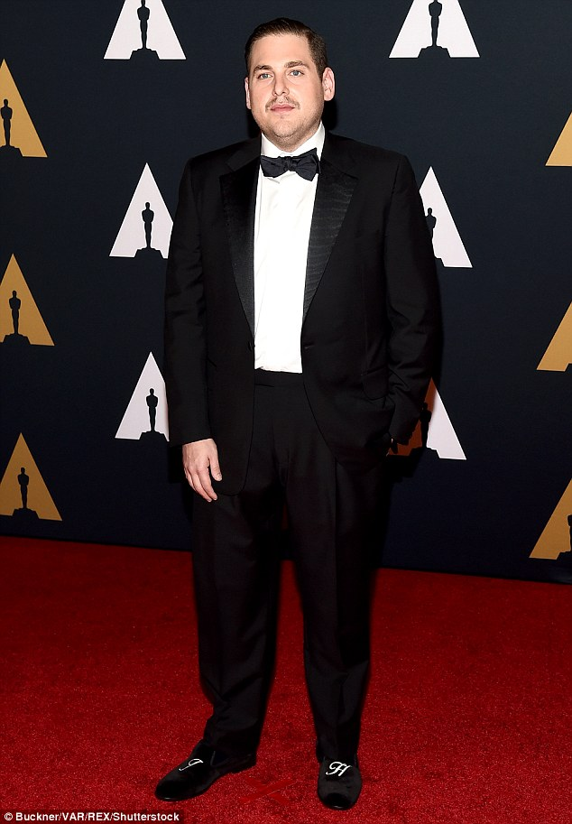 Cool guy: Jonah Hill looked like a classic movie star in his bow tie, blazer and trousers; he rocked shoes that his initials emblazoned on them