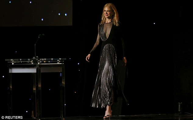 Gliding: Nicole Kidman headed to the microphone to present an award