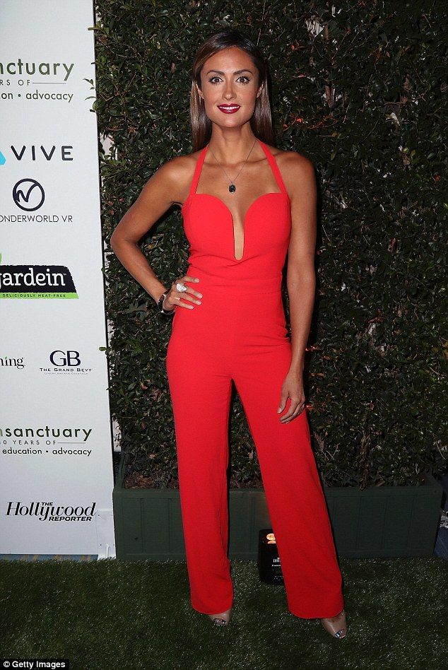 Scarlet siren: Actress Katie Cleary flaunted her svelte figure in a skintight red jumpsuit