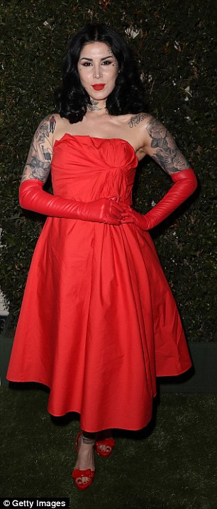 Retro lady: Tattoo artist Kat Von D looked like a modern day pin-up in a red ruched strapless dress
