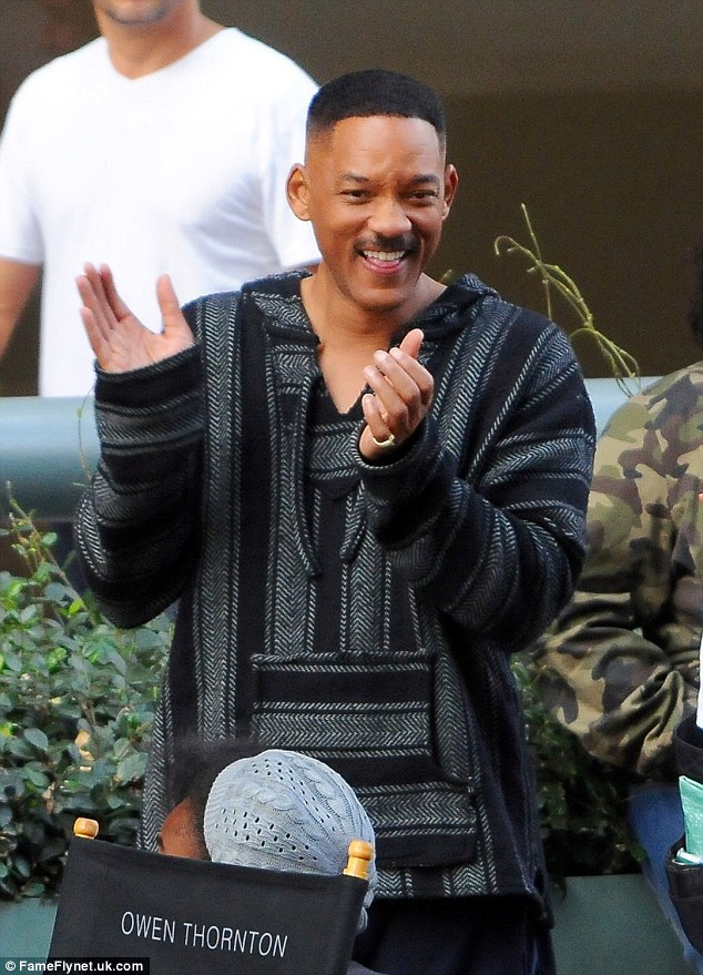 Moment of joy: Will Smith was spotted having a laugh on Saturday whilst on set for his forthcoming film Bright