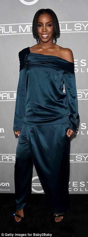 One of a kind?Kelly went with a distinctive dark blue one-shoulder jumpsuit dress hybrid