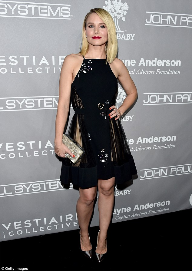 More floral fashion:Kristen Bell, 36, and formerly the star of Veronica Mars also went with a halter neck number, though hers was black and knee-length