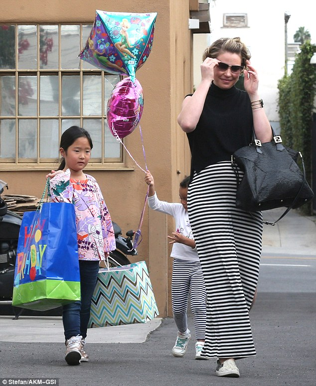They've got their hands full! Katherine's little girls juggled big gift bags as well as a collection of balloons