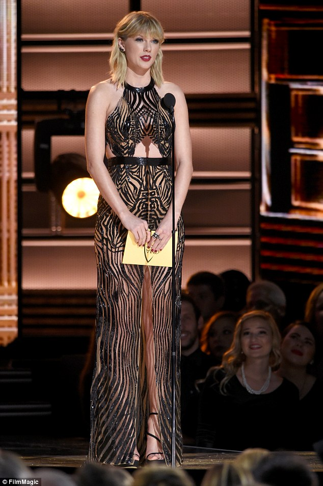 Queen of breakup anthems: Taylor, shown last week at the CMA Awards, is known for writing songs about her exes