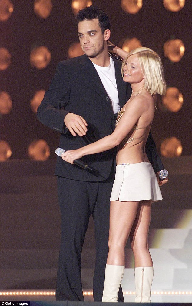 Former flame? Robbie, who was previously reported to be in a relationship with Spice Girls' Geri Halliwell (seen together in 2001)