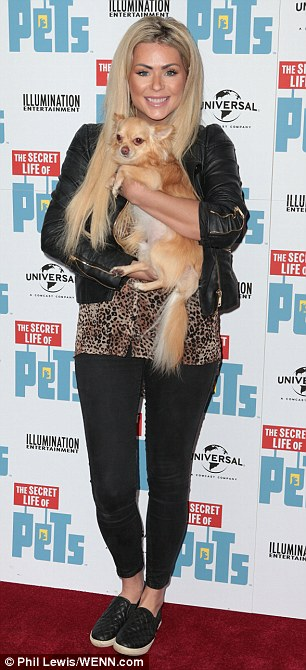 Furry friend:Nicola McLean used her furry companion as the ultimate accessory, cuddling her pet pooch against her leopard print top which was teamed with skinny black jeans
