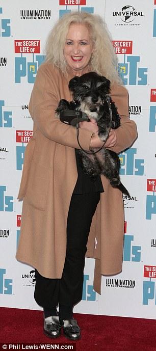 Pooch pals: TOWIE star Debbie Douglas (L) brought her pet along to the premiere