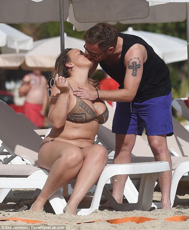 Sharing a smooch: The pair looked very loved-up on their idyllic getaway