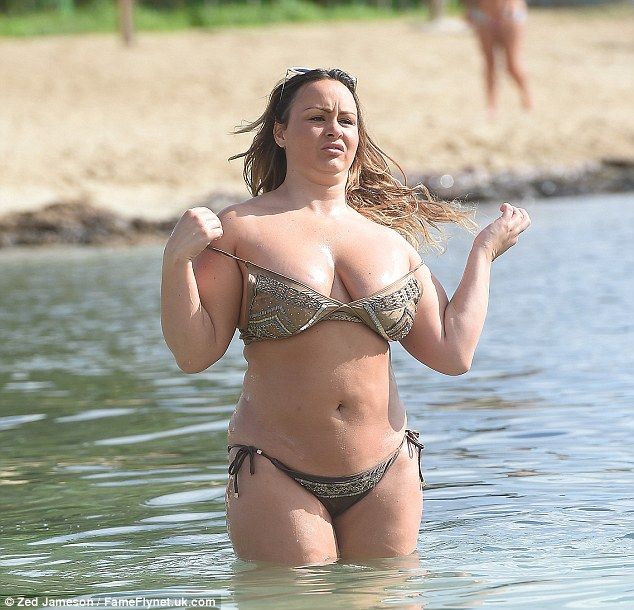 Chest a glimpse! Chanelle threatened to spill out of her tiny bikini top as she hit the sea