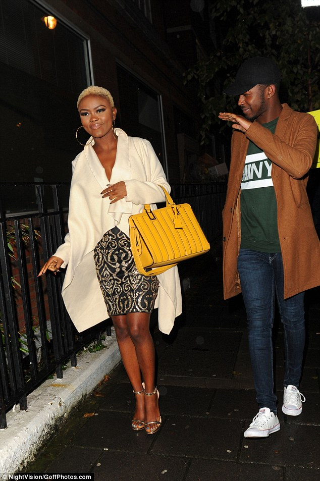 In the mood to party: X Factor star Gifty Louise also hit the party, looking chic in a sparkly black and gold number
