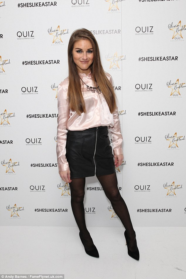 Party outfit: Big Brother favouriteNikki Grahame teamed a pink satin shirt with a leather mini